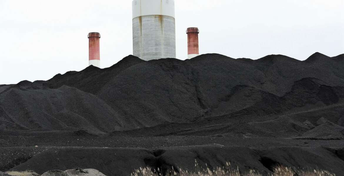 This Jan. 25, 2017, photo shows coal piled at the Gallatin Fossil Plant in Gallatin, Tenn. Environmental groups are taking the Tennessee Valley Authority, the nation's largest public utility, to trial over whether waste from the coal-fired power plant near Nashville polluted the Cumberland River. A trial opens Monday, Jan. 30, in federal court in Nashville as the groups claim coal ash waste illegally seeped into the Cumberland River. (AP Photo/Mark Humphrey)