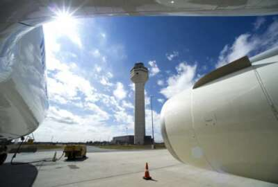 In this photo taken Sept. 27, 2016, the Dulles International Airport Air Traffic Control Tower is seen from the door of a Boeing 777 aircraft in Sterling, Va. The Federal Aviation Administration (FAA) isn't prepared to handle major air traffic control outages despite promises to update contingency plans made after extended disruptions in 2014 and 2015, a government watchdog said Friday, Jan. 13, 2017. (AP Photo/Cliff Owen)