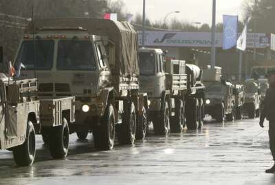 U.S. Army vehicles cross the Polish border in Olszyna, Poland, Thursday, Jan. 12, 2017 heading for their new base in Zagan. First U.S. troops arrive in Zagan in western Poland as part of deterrence force of some 1,000 troops to be based here and reassure Poland that is worried about Russia's activity. (AP Photo/Czarek Sokolowski)
