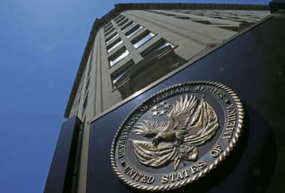 FILE - In this June 21, 2013, file photo, the seal a fixed to the front of the Department of Veterans Affairs building in Washington. Veterans health care remains a