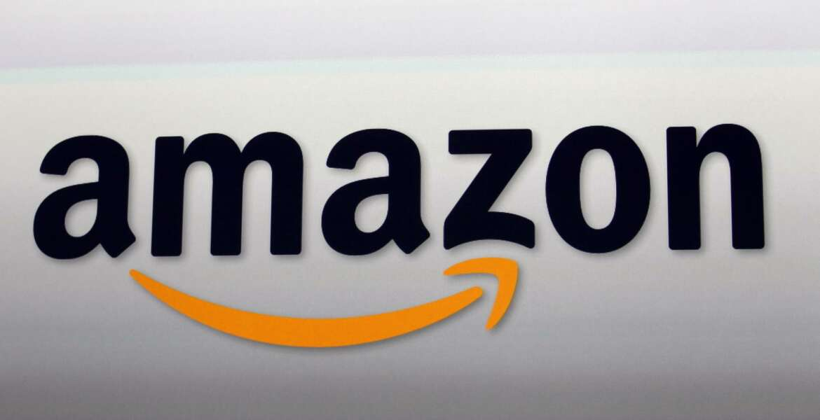 FILE - This Sept. 6, 2012, file photo, shows the Amazon logo in Santa Monica, Calif. Amazon's cloud-computing service Amazon Web Services experienced problems in its eastern U.S. region, Tuesday, Feb. 28, 2017, causing widespread problems for thousands of websites and apps. (AP Photo/Reed Saxon, File)