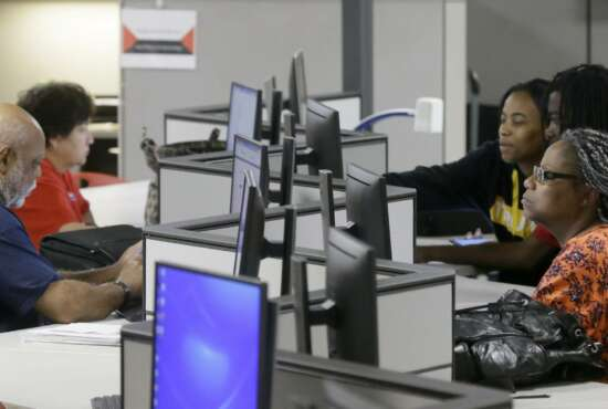 In this Friday, March 10, 2017, photo, job seekers use computers to search for a job at the Texas Workforce Solutions office in Dallas. On Thursday, March 16, 2017, the Labor Department reports on the number of jobless claims the week before. (AP Photo/LM Otero)