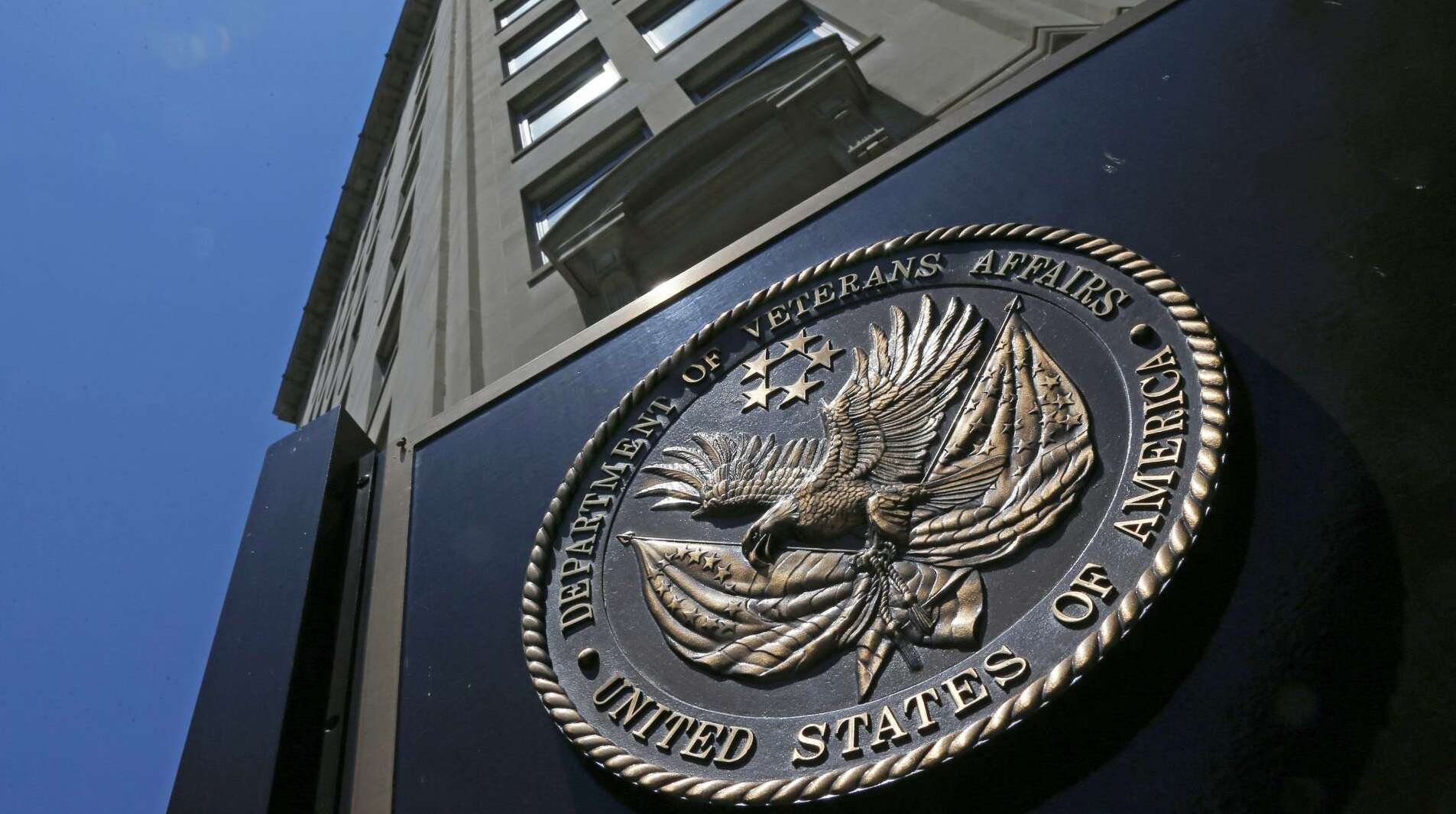 FILE - In this June 21, 2013, file photo, the seal affixed to the front of the Department of Veterans Affairs building in Washington. The Department of Veterans Affairs is warning of a rapidly growing backlog for veterans who seek to appeal decisions involving disability benefits, saying it will need much more staff even as money remains in question due to a tightening Trump administration budget.  (AP Photo/Charles Dharapak, File)