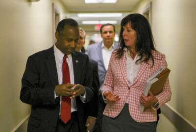 "Housing and Urban Development Secretary Ben Carson, left, speaks with Michelle Heritage, director of a shelter program, inside a shelter in Columbus, Ohio, Wednesday, April 26, 2017. Carson said Wednesday he expects to release a policy agenda within the next few months that delivers ""bang for the buck,"" partly by encouraging more private-sector collaboration. (AP Photo/Dake Kang)"