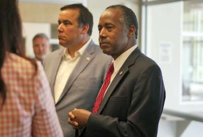 """Housing and Urban Development Secretary Ben Carson meets with city and housing officials inside a shelter in Columbus, Ohio, Wednesday, April 26, 2017. Carson said Wednesday he expects to release a policy agenda within the next few months that delivers """"bang for the buck,"""" partly by encouraging more private-sector collaboration. (AP Photo/Dake Kang)"""