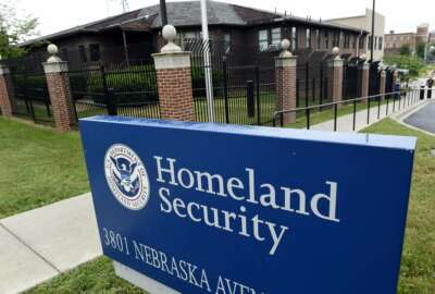 FILE - In this June 5, 2015, file photo, the Homeland Security Department headquarters in northwest Washington. The U.S. Homeland Security Department says nearly 740,000 foreigners who were supposed to leave the country during a recent 12 month period overstayed their visas and count released Monday, May 22, 2017, includes people who arrived in the U.S. by plane or boat but does not include ground border crossings. (AP Photo/Susan Walsh, File)