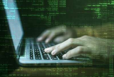 hacker hands at work with graphic user interface around
