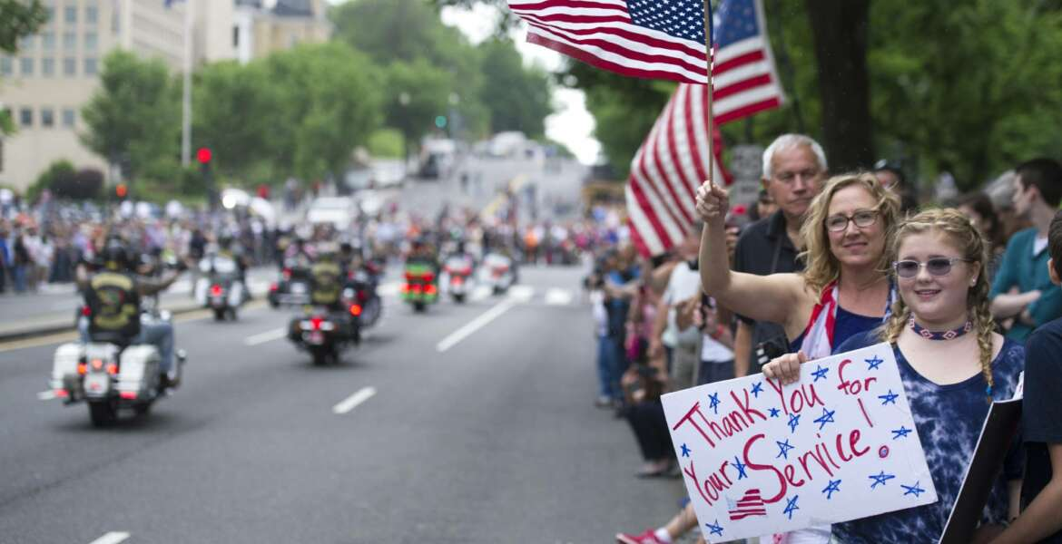 Supporters line the street as motorcyclists participate in the 30th anniversary of the Rolling Thunder 'Ride for Freedom' demonstration in Washington, Sunday, May 28, 2017. Rolling Thunder seeks to bring full accountability for all U.S. prisoners of war and missing in action (POW/MIA) soldiers. (AP Photo/Cliff Owen)