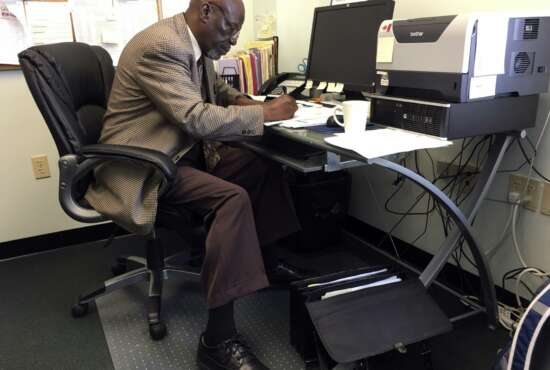 In this May 18, 2017, photo, Nathan Singletary, 67, a social worker for 40 years, fills out paperwork at the AARP Foundation in Harrisburg, Pa. Singletary is beyond the traditional retirement age, but he's only just beginning a new career - helping other low-income, unemployed Americans over age 55 find jobs. Singletary got his job through the half-century-old Senior Community Service Employment Program, a training and placement program underwritten by taxpayers aimed at putting older Americans back into the workforce. (AP Photo/Laurie Kellman)