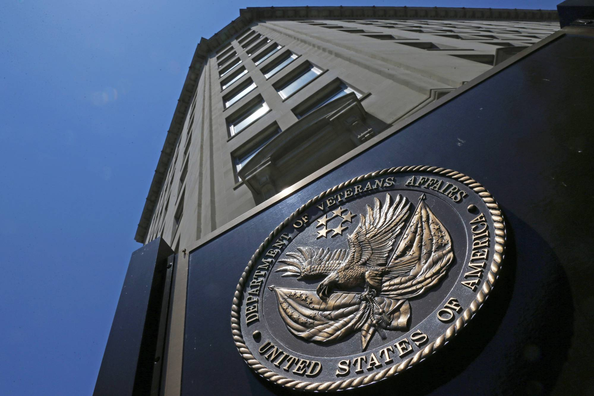 FILE - In this June 21, 2013, file photo, the seal affixed to the front of the Department of Veterans Affairs building in Washington. The advocacy group  National Industries for the Blind filed a lawsuit Wednesday, May 24, 2017,  in U.S. District Court in Washington alleging the agency ignored a longstanding law when it changed contracting rules used for decades to give jobs to the blind. (AP Photo/Charles Dharapak, File)