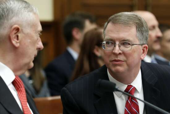 Defense Secretary Jim Mattis, left, and Defense Under Secretary and Chief Financial Office David Norquist, talk before a House Armed Services Committee hearing on the defense budget for the 2018 fiscal year, which begins Oct. 1, on Capitol Hill, Monday, June 12, 2017, in Washington. (AP Photo/Alex Brandon)