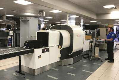 In this Wednesday, June 14, 2017, photo provided by American Airlines, a Transportation Security Administration officer operates an L3 ClearScan baggage screener, featuring 3-D scanning technology, at a checkpoint at Phoenix Sky Harbor International Airport, in Phoenix. The TSA says the technology improves the ability to find bombs. (Ross Feinstein/American Airlines via AP)