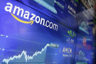 FILE - In this Tuesday, May 30, 2017, file photo, the Amazon logo is displayed at the Nasdaq MarketSite, in New York's Times Square. Amazon announced Tuesday, June 20, 2017, that it's testing a new service for its Prime members that lets customers try on the latest styles before they buy at no upfront charge, take seven days to decide and only pay for what they keep. (AP Photo/Richard Drew, File)