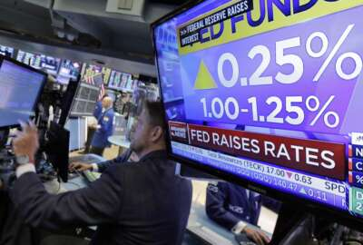 The rate decision of the Federal Reserve is shown on a television on the floor of the New York Stock Exchange, Wednesday, June 14, 2017. The Federal Reserve is hiking a key interest rate for the second time this year and is planning to reduce the size of its $4.5 trillion balance sheet as well. Fed officials voted 8-1 to raise the federal funds rate to a range of 1 to 1.25 percent. (AP Photo/Richard Drew)