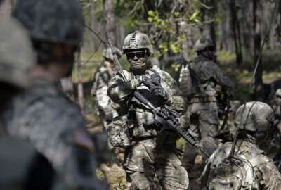 In this photo taken Friday, April 21, 2017 paratroopers with the 82nd Airborne Division's 3rd Brigade Combat Team participate in a training exercise at Fort Bragg, N.C. The Army is planning to triple the amount of bonuses it's paying this year to more than $380 million in a bid to expand its ranks. The money includes new incentives to woo reluctant soldiers to re-enlist.  (AP Photo/Gerry Broome)
