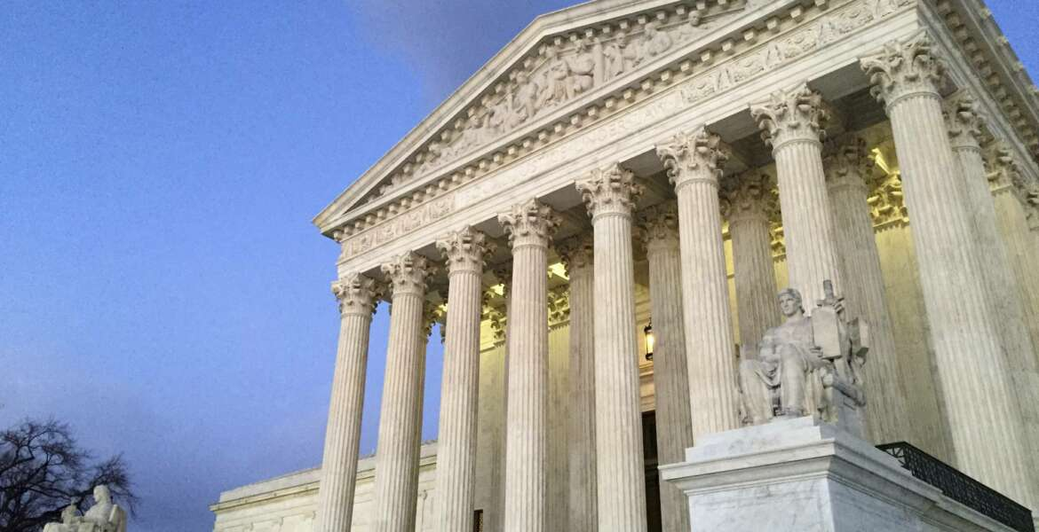 FILE - In this Feb. 13, 2016, file photo, people stand on the steps of the Supreme Court at sunset in Washington. Conservative groups are wasting little time in trying to deal a crippling blow to labor unions now that Justice Neil Gorsuch has joined the Supreme Court. A First Amendment clash over public sector unions left the justices deadlocked last year after the death of Justice Antonin Scalia. But union opponents have quickly steered a new case through federal courts in Illinois and they plan to appeal it to the high court on Tuesday, June 6, 2017. (AP Photo/Jon Elswick, file)