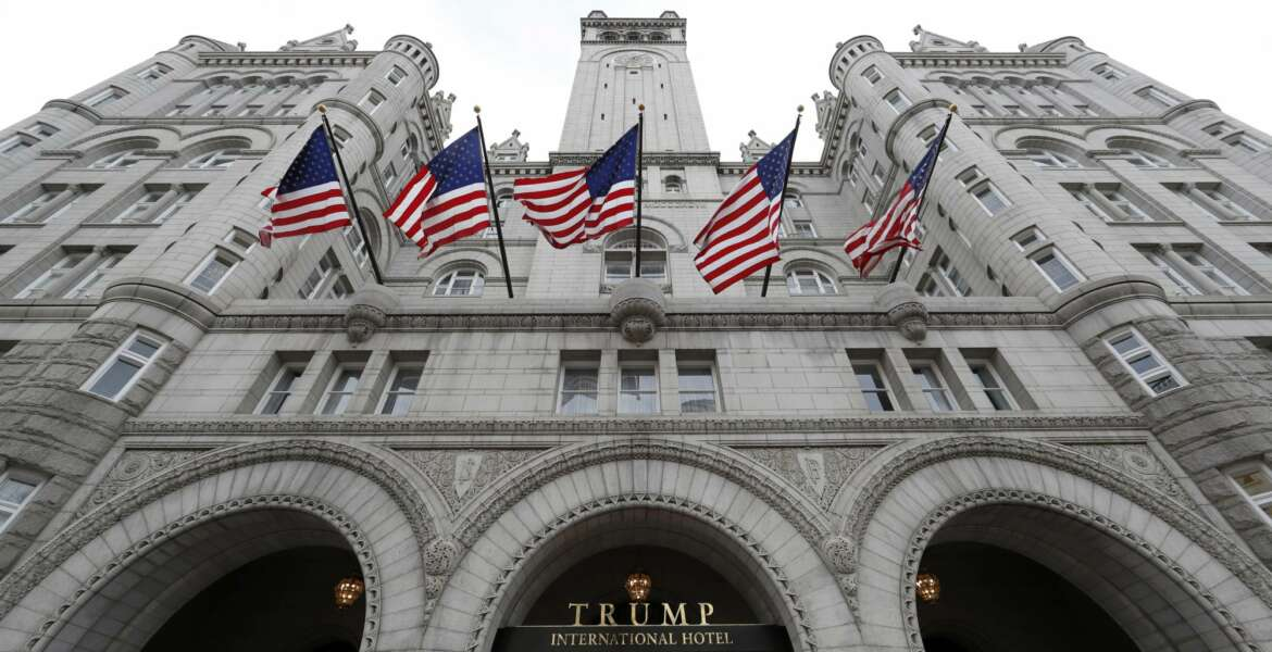 FILE - The Trump International Hotel at 1100 Pennsylvania Avenue NW, is seen Wednesday, Dec. 21, 2016 in Washington.   President Donald Trump keeps taking time out from governing to run for re-election.  On Wednesday night, he'll attend his first 2020 campaign fundraiser, at his Washington hotel. He's already spent five evenings at political rallies, always in front of an audience of thousands of fans who are selected by his campaign aides.  (AP Photo/Alex Brandon)
