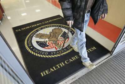 FILE - In this April 2, 2015, file photo, a visitor leaves the Sacramento Veterans Affairs Medical Center in Rancho Cordova, Calif. The number of veterans seeking health care but ending up on waiting lists of one month or more is 50 percent higher now than it was a year ago when a scandal over false records and long wait times wracked the Department of Veterans Affairs, The New York Times reported Saturday, June 20, 2015, online ahead of its Sunday editions. (AP Photo/Rich Pedroncelli, File)