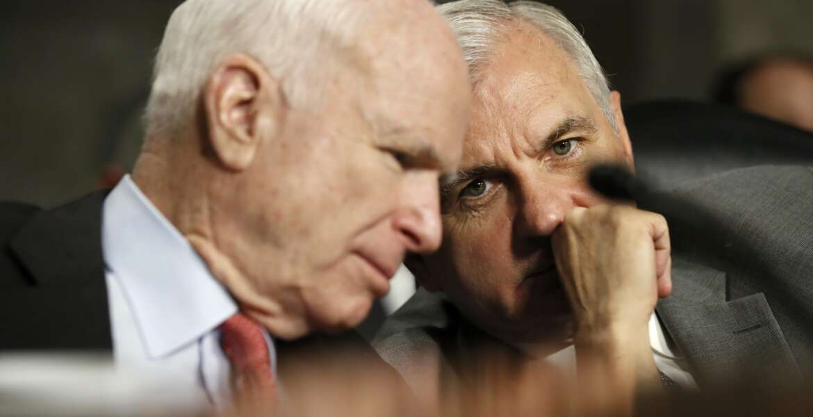 Senate Armed Services Committee Chairman Sen. John McCain, R-Ariz., left, talks to the committee's ranking member Sen. Jack Reed, D-R.I. on Capitol Hill in Washington, Tuesday, July 11, 2017, during the committee's confirmation hearing for Navy Secretary nominee Richard Spencer.  (AP Photo/Jacquelyn Martin)