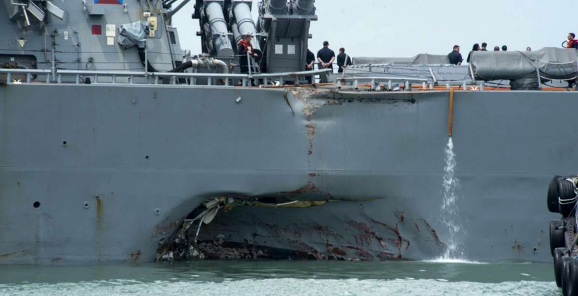 Damage to the portside is visible as the Guided-missile destroyer USS John S. McCain (DDG 56) steers towards Changi naval base in Singapore following a collision with the merchant vessel Alnic MC Monday, Aug. 21, 2017. The USS John S. McCain was docked at Singapore's naval base with