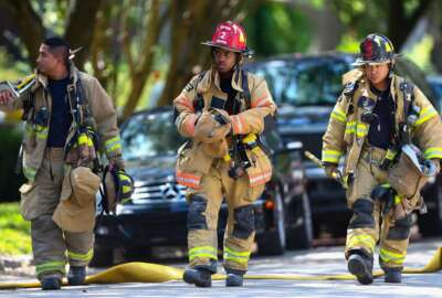 Houston firefighters arrive a the scene of a