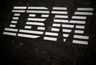 FILE - In this April 26, 2017, file photo, the IBM logo is displayed on the IBM building in Midtown Manhattan, in New York. In a judge's ruling dated Friday, Aug. 4, 2017, IBM Corp. owes the state of Indiana $78 million in damages stemming from the company's failed effort to automate much of Indiana's welfare services. Indiana and IBM sued each other in 2010 after then-Gov. Mitch Daniels canceled the company's $1.3 billion contract. (AP Photo/Mary Altaffer, File)