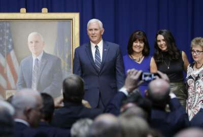 Vice President Mike Pence poses for a photo with is family, mother Nancy Pence-Fritsch, right, Karen Pence and Audrey Pence after the unveiling of his official state portrait, Friday, Aug. 11, 2017, in Indianapolis. (AP Photo/Darron Cummings)