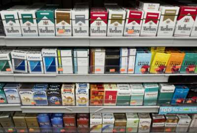 Cigarettes are displayed on a shelf, Monday, Aug. 28, 2017, in New York. Mayor Bill de Blasio is expected to sign legislation raising the legal minimum price for a pack of cigarettes to $13. The hike from $10.50 further cements the city's claim on having among the most expensive cigarettes in the country. (AP Photo/Mark Lennihan)