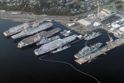An aerial view of the Puget Sound Naval Shipyard and Intermediate Maintenance Facility in Bremerton, Washington