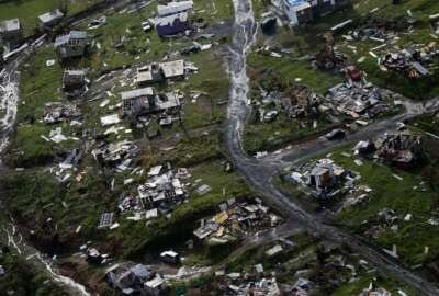 Destroyed communities are seen in the aftermath of Hurricane Maria in Toa Alta, Puerto Rico, Thursday, Sept. 28, 2017. The aftermath of the powerful storm has resulted in a near-total shutdown of the U.S. territory's economy that could last for weeks and has many people running seriously low on cash and worrying that it will become even harder to survive on this storm-ravaged island. (AP Photo/Gerald Herbert)