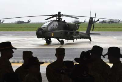 Soldiers from the US Army 1st Cavalry Brigade, 1st Cavalry Division, gather under a hangar in front of helicopters at Chievres Air Base in Chievres, Belgium, Tuesday, Oct. 24, 2017. The 1st Cavalry Brigade made a refueling stop at the base in Belgium on it's way to a nine-month rotation in Illesheim, Germany to support Operation Atlantic Resolve and other training missions across Europe. (AP Photo/Geert Vanden Wijngaert)