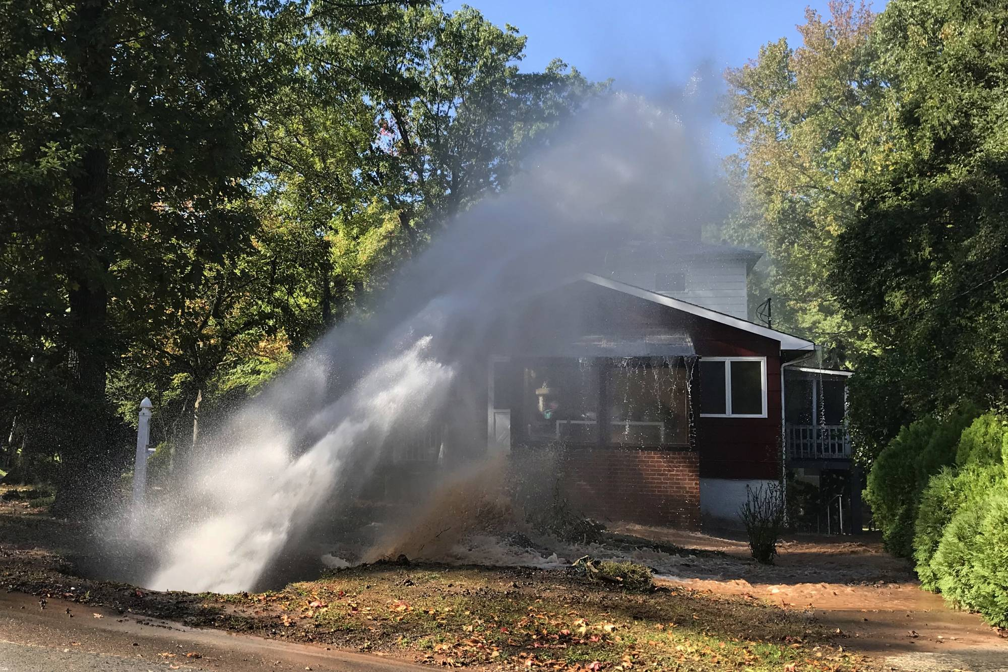 NYC water main breaks, sending geyser blasting onto house