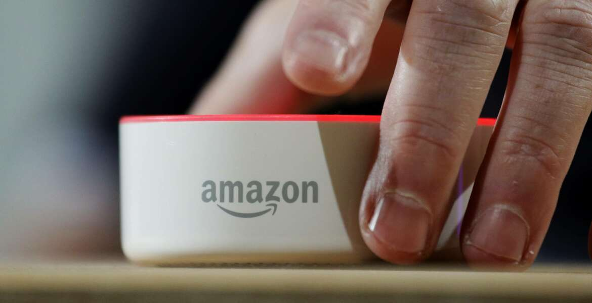 FILE - In this Wednesday, Sept. 27, 2017, file photo, an Amazon Echo Dot is displayed during a program announcing several new Amazon products by the company, in Seattle. Amazon.com, Inc. reports earnings Thursday, Oct. 26, 2017. (AP Photo/Elaine Thompson, File)