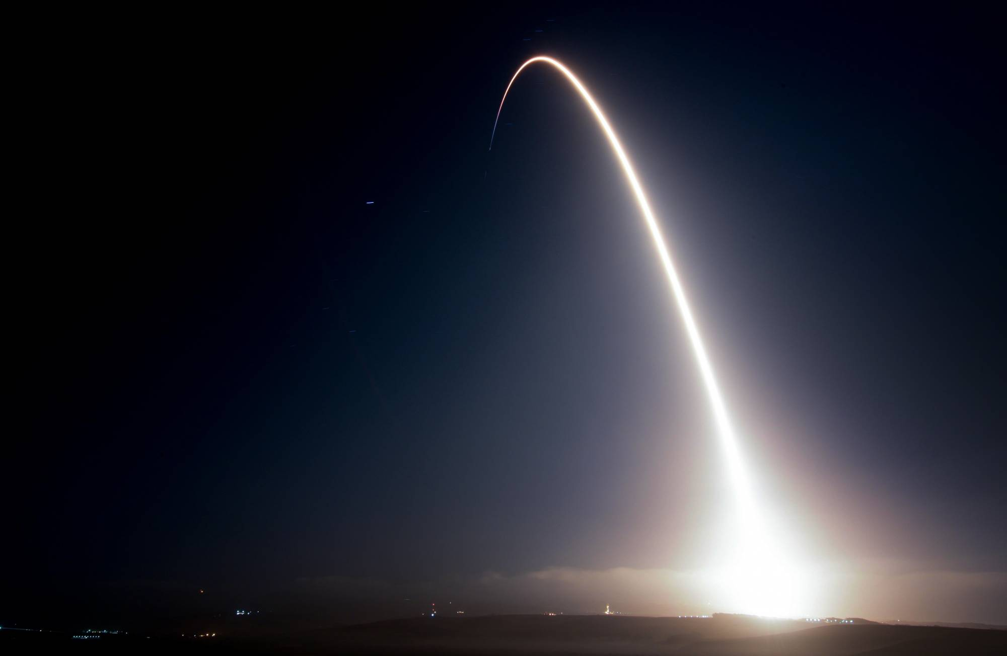 This photo provided by Vandenberg Air Force Base shows the launch of a SpaceX Falcon 9 rocket from the Space Launch Complex-4 at Vandenberg Air Force Base, Calif., Monday, Oct. 9, 2017. Ten new satellites for Iridium Communications Inc. have been carried into orbit by a SpaceX Falcon 9 rocket launched from California. The booster lifted off from coastal Vandenberg Air Force Base before dawn Monday and its first stage successfully returned from space and set down on a landing platform floating in the Pacific Ocean as the second stage went on to deploy the satellites in orbit. (Senior Airman Ian Dudley/Vandenberg Air Force Base via AP)
