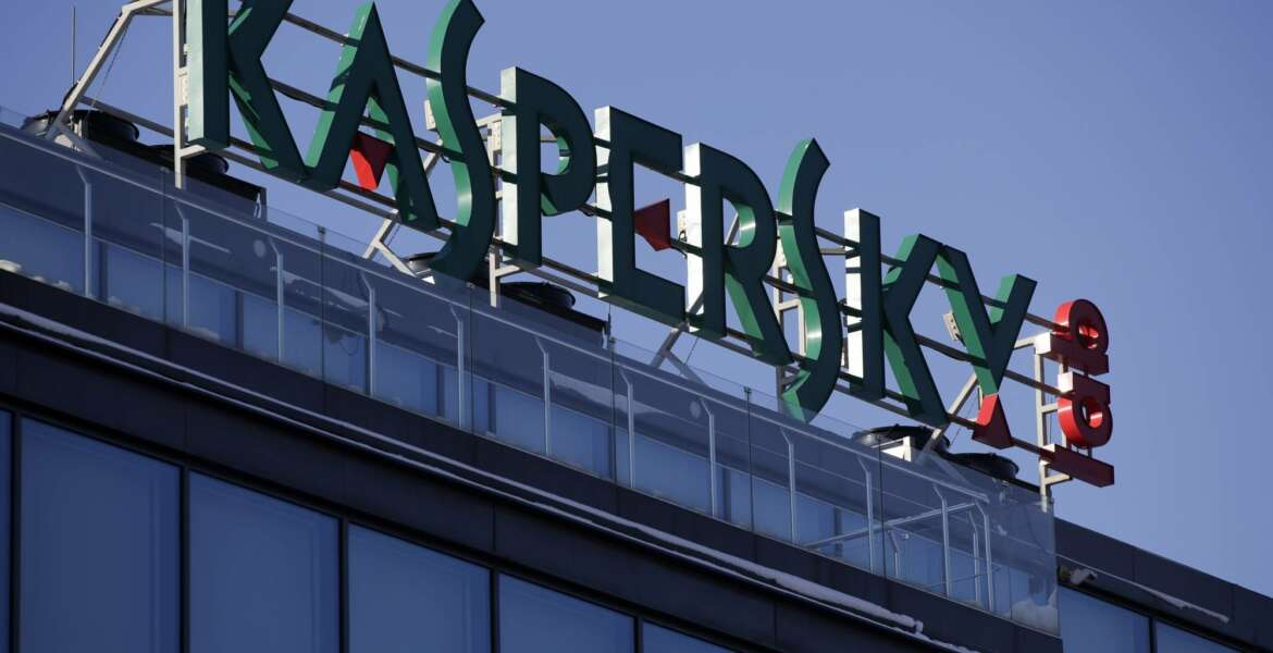 FILE - This Monday, Jan. 30, 2017, file photo shows a sign above the headquarters of Kaspersky Lab in Moscow. On Monday, Oct. 23, 2017, Kaspersky Lab said it will open up its anti-virus software to outside review as it deals with security concerns. The company is making the move a month after the U.S. government barred agencies from using its software. (AP Photo/Pavel Golovkin, File)