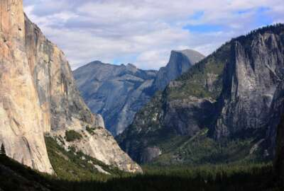 FILE - This Oct. 2, 2013, file photo, shows a view seen on the way to Glacier Point trail in the Yosemite National Park, Calif. The National Park Service is floating a proposal to increase entrance fees at 17 of its most popular sites next year. (AP Photo/Tammy Webber, File)