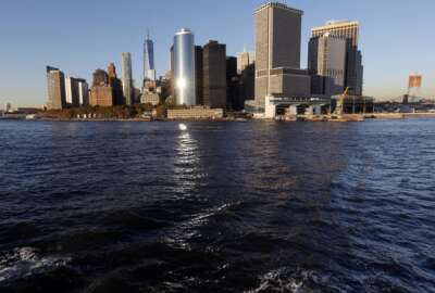 Water from New York Harbor surrounds the southern tip of New York's Manhattan borough on Tuesday, Oct. 17, 2017, seen from aboard a Staten Island Ferry. Superstorm Sandy roared ashore five years ago, Monday, Oct. 29, 2012, devastating the coastlines of New Jersey, New York and parts of Connecticut and becoming one of the costliest storms in U.S. history. (AP Photo/Seth Wenig)