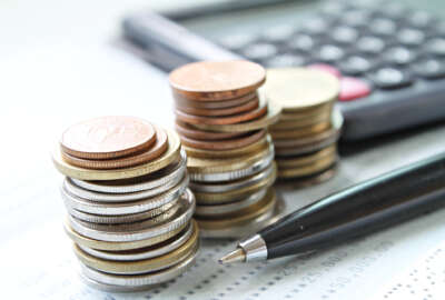 Business, finance, saving money, banking, loan, investment, taxes or accounting concept : Coins stack, pen and calculator on office desk table