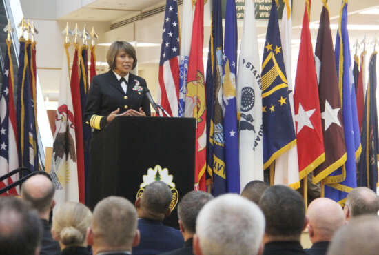 Navy Vice Adm. Raquel C. Bono, director, Defense Health Agency, provides remarks during the MHS GENESIS Recognition Ceremony Nov. 15 at Madigan Army Medical Center. The ceremony commemorated the deployment of the Department of Defense's new electronic health record at its four initial fielding sites in the Pacific Northwest - Madigan, Naval Hospital Bremerton, Naval Health Clinic Oak Harbor and Fairchild Air Force Base.    During the ceremony, Bono presented awards to each of the MTF site commanders: Air Force Col. Michaelle Guerrero, commander, 92nd Medical Group at Fairchild; Navy Capt. Christine Sears, commanding officer, Oak Harbor; Navy Capt. Jeffrey Bitterman, commanding officer, Bremerton; and Army Col. Michael Place, commander, Madigan.