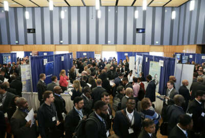 Applicants lined up throughout the civic center floor to interview and talk with federal agencies about potential IT and cyber positions.