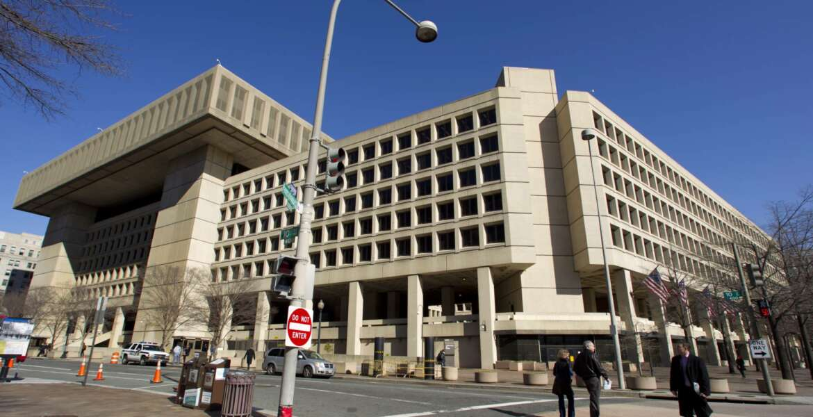 FILE - This Feb. 3, 2012, file photo shows FBI headquarters in Washington. Many U.S. diplomatic, military and government figures were not told about Russia-linked attempts to hack into their emails, even though the FBI knew they were in the Kremlin's crosshairs, The Associated Press has learned. (AP Photo/Manuel Balce Ceneta, File)