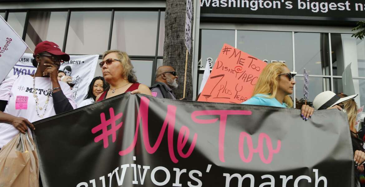 FILE - In this Nov. 12, 2017, file photo, participants rally outside CNN's Hollywood studios on Sunset Boulevard to take a stand against sexual assault and harassment for the #MeToo March in the Hollywood district of Los Angeles. A spate of recent public revelations, including the spontaneous #metoo discussions on social media, is emboldening many victims of sexual harassment to speak up, but many still remain silent. (AP Photo/Damian Dovarganes, File)