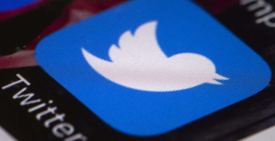 This April 26, 2017, file photo shows the Twitter app on a mobile phone in Philadelphia. Russian agents on Twitter attempted to deflect bad news around President Trump's election campaign in October 2016 and refocused criticism on the mainstream media and the Clinton campaign, according to an exclusive AP analysis of an archive of deleted accounts. (AP Photo/Matt Rourke, File)