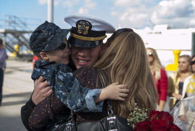 A U.S. Sailor reunites with his family at Naval Station San Diego, Calif., Oct. 29, 2013, after returning from a seven-month deployment aboard the guided missile cruiser USS Princeton (CG 59). The Princeton conducted maritime security operations, theater security cooperation efforts and support missions for Operation Enduring Freedom in the U.S. 5th Fleet and U.S. 7th Fleet areas of responsibility.