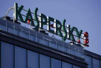 FILE - This Monday, Jan. 30, 2017, file photo shows a sign above the headquarters of Kaspersky Lab in Moscow. Britain's cybersecurity agency has told government departments not to use antivirus software from Moscow-based firm Kaspersky Lab, it was reported Saturday, Dec. 2, 2017. (AP Photo/Pavel Golovkin, File)