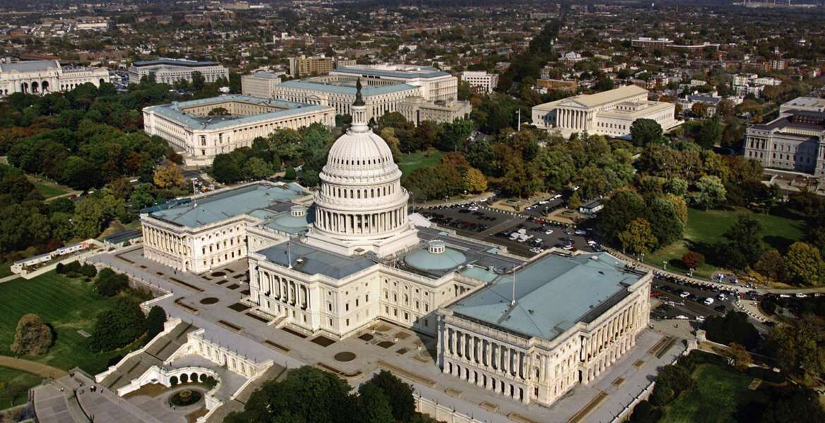 FILE - In this Oct. 24, 2001, file photo, the United States Capitol in Washington, D.C. is shown in an aerial view. The GOP-led Congress is hoping to approve a must-pass spending bill as the clock ticks toward potential government shutdown this weekend. (AP Photo/J. Scott Applewhite, File)