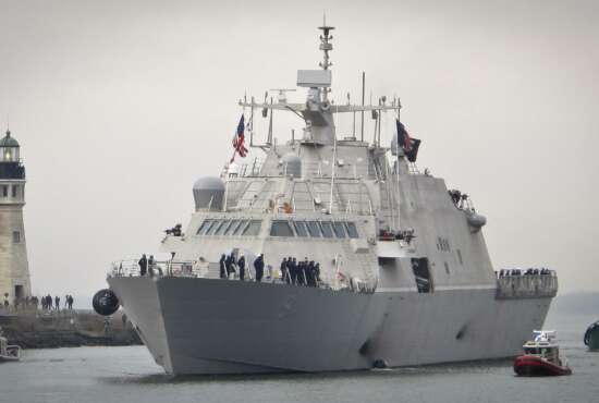 The new USS Little Rock arrives at Buffalo harbor with a police and fireboat escort, Monday, Dec. 4, 2017, in Buffalo, N.Y. The littoral combat ship will be docked on the Lake Erie waterfront until its commissioning Dec. 16, 2017. (AP Photo/Carolyn Thhompson)