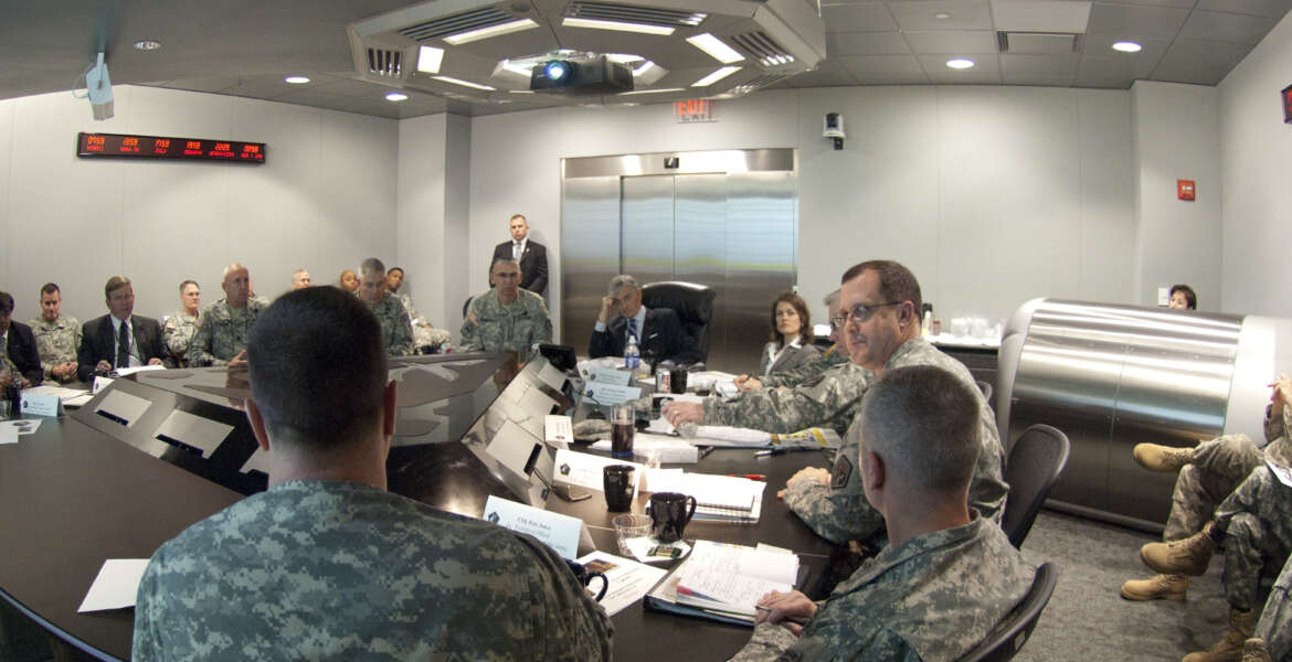 Secretary of the Army John McHugh receives an update briefing from various staff members of U.S. Army Cyber Command during a visit April 2, 2012, Fort Belvoir, Va. U.S. Army Cyber Command is the newest Army Service Component Command. (U.S. Army photo by Spc. John G. Martinez) (Photo Credit: Spc. John G. Martinez)