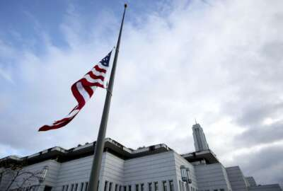 The U.S. flag flies at half-staff during a public viewing of Thomas S. Monson, President of The Church of Jesus Christ of Latter-day Saints  at the LDS Conference Center in Salt Lake City, Utah, Thursday, Jan. 11, 2018. Monson spent more than five decades serving in top church leadership councils, making him a well-known face and personality to multiple generations of Mormons.  He died on Jan. 2 at the age of 90.  (Kristin Murphy/Deseret News via AP)