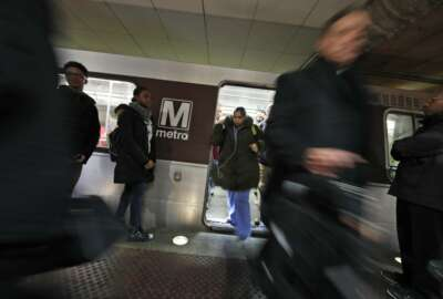 Riders wait to board as others depart a Metro train in the Gallery Place-Chinatown Metro Station, Thursday, Jan. 11, 2018, in Washington. Washington's Metro system has become internationally synonymous with delays, breakdowns and smoke-filled tunnels. (AP Photo/Alex Brandon)
